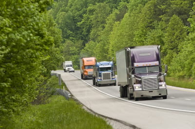 trucks driving on a sunny day